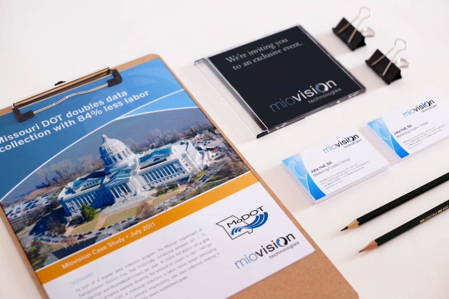 Image of brochure, CD case, business card and pencils together