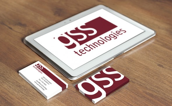 Tablet and business cards with GSS logo