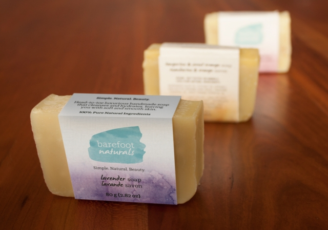 Three natural soaps with a Barefoot Naturals label